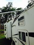 Backside of the camper.  Awning poles going the wrong direction.