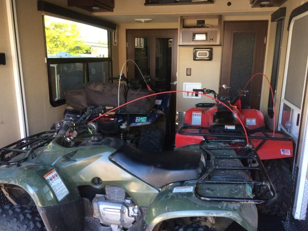 Rancher 420 and two Recon 250s in the garage
