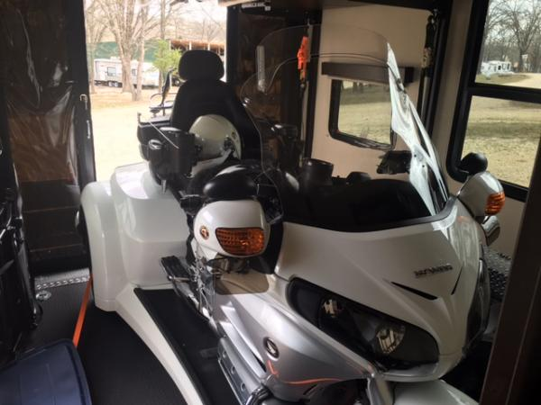 """Looking out back of garage. We were not sure this GW trike would fit in the 11 foot garage, but it did with a little room to spare. Trike is 5' wide and 9'6"""" long."""