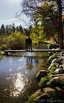 A Young Family on a short Foot Bridge Spanning the Beginning of the Mississippi River, Itasca, MN