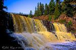 """Gooseberry Falls on Minnesota's North Shore""   The falls were running wide and full from the recent rains; and the sun happened to catch the far..."